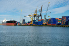 Loading/unloading shipping containers in the port of Rotterdam, Netherlands. Stock Images