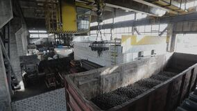 Loading into a wagon, production of balls, Electromagnetic crane with metal ball, smanufacture of bearings