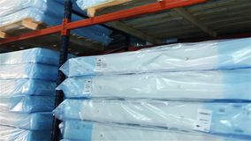 Loading of a warehouse mattresses, orthopedic mattresses on shelves, a warehouse complete set mattresses, an industrial