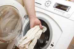 Loading the washing machine Stock Photos