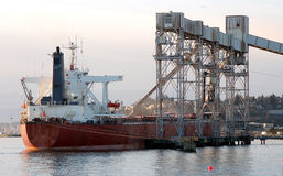 Loading Wheat for Export. Close Up of a Ship at the dock Stock Photos