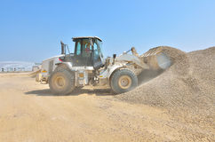 Loading the wheel dozer at concrete plant Stock Image