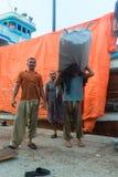 Loading workman in Dubai Creek wharfage Royalty Free Stock Photography