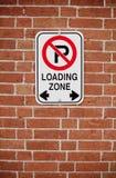 Loading zone sign on brick background Stock Photos