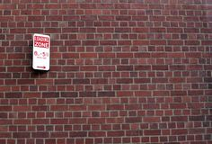 Loading zone sign on brick wall Royalty Free Stock Photography