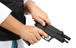 Loadng ammunition. Swat officer loading ammunition of pistol on white background royalty free stock images