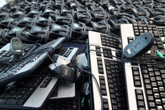 Loads of Keyboards Mice and phones Royalty Free Stock Photo