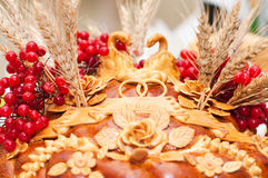 Loaf. National wedding loaf with guelder-rose, swans, rings and salt Royalty Free Stock Photography