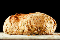 Loaf of Artisinal Bread Covered with Pepita Seeds Stock Images