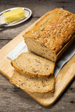 Loaf of Banana Bread on Wooden Table Royalty Free Stock Image