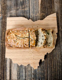 Loaf of Banana Nut Bread on Ohio Board. Loaf of Banana Nut Bread on Ohio cutting board and rustic table backdrop Stock Photography