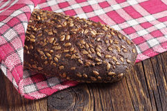 Loaf of black bread with seeds Royalty Free Stock Images