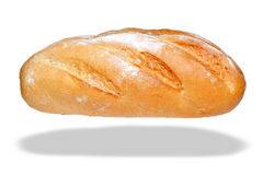 Loaf Bloomer bread isolated on white. Photo of a white bloomer loaf of bread, isolated on a white background with floating shadow Stock Photography