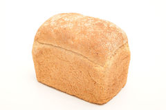 Loaf of bread. Photograph of a loaf of bread shot in studio against a white background Stock Photos