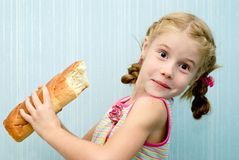 Loaf of bread. Portrait of a little girl with a loaf of bread stock photos