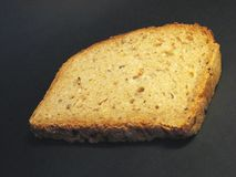 Loaf of bread 3. Loaf of bread lying on black shadow background stock photography