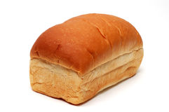 Loaf of Bread. Angled view of a loaf of white bread, not sliced, on a white background Royalty Free Stock Photos