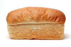 Loaf of Bread. Side view of a loaf of white bread, not sliced, on a white background royalty free stock images