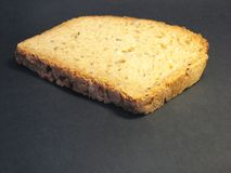 Loaf of bread 5. Loaf of bread lying on black shadow background royalty free stock images