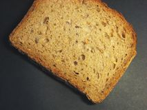 Loaf of bread 6. Loaf of bread lying on black shadow background royalty free stock photo