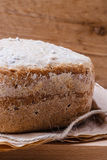 Loaf of bread on backing paper Stock Photo