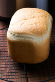 The loaf of bread baked in the bread machine Royalty Free Stock Images