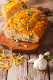 Loaf of bread baked with cheddar cheese, garlic and herbs closeu Royalty Free Stock Photos