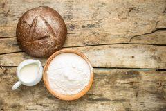 Loaf of bread with bakery ingredients and copy space. Stock Image