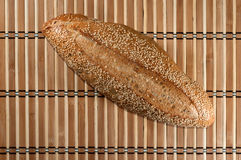 Loaf of bread on bamboo mat Stock Photos