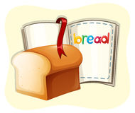 Loaf of bread and a book Stock Photo