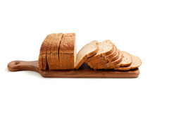Loaf of bread on a bread board Stock Images