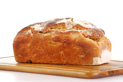 Loaf of bread on breadboard. Loaf of bread isolated on white background Stock Photos