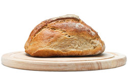 Loaf of Bread on Chopping Board Stock Photos