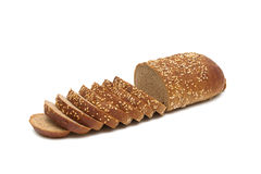 Loaf of bread cut into pieces on a white background Royalty Free Stock Images