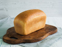 Loaf of bread on cutting board Stock Photography