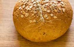 Loaf of bread with earned cereal Royalty Free Stock Photos