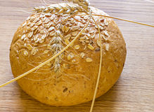 Loaf of bread with earned cereal Royalty Free Stock Photo