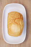 Loaf of bread, food closeup. Loaf of bread on wooden background, food closeup Royalty Free Stock Photos