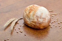 Loaf of bread with grains of wheat Royalty Free Stock Photography