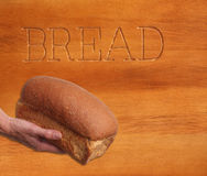 Loaf of bread, hand held. Stock Photography