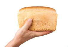 Loaf of bread in his hand Stock Photo