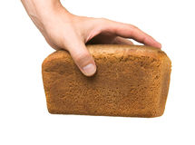 Loaf of bread in his hand Royalty Free Stock Image