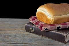 Loaf of bread on Holy Bible Royalty Free Stock Photos