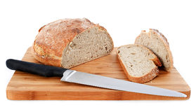 Loaf of bread and knife Royalty Free Stock Images