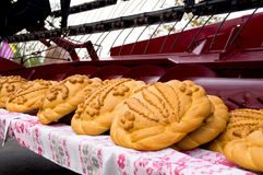 Loaf of bread laid out on the header harvester Stock Images