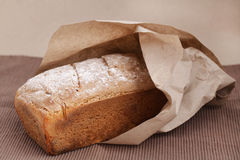 Loaf of bread made of corn flour wrapped in brown Stock Image