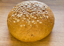 Loaf of bread on oak plate Royalty Free Stock Image
