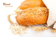 Loaf of bread with oat flakes Royalty Free Stock Images