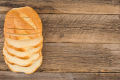Loaf of bread on a old  wooden table. Top view. Stock Photos