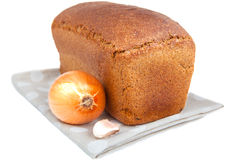 Loaf of bread,onion and garlic clove isoleted on white Royalty Free Stock Photos